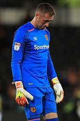Hull City goalkeeper Allan McGregor stands dejected