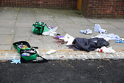 © Licensed to London News Pictures. 31/03/2019. London, UK. Blood stained clothing at the crime scene on Fore Street in Edmonton, north London where a person was stabbed just after 9.30am this morning. According to the The victim was transferred to a hospital by Air Ambulance and his condition is unknown. Photo credit: Dinendra Haria