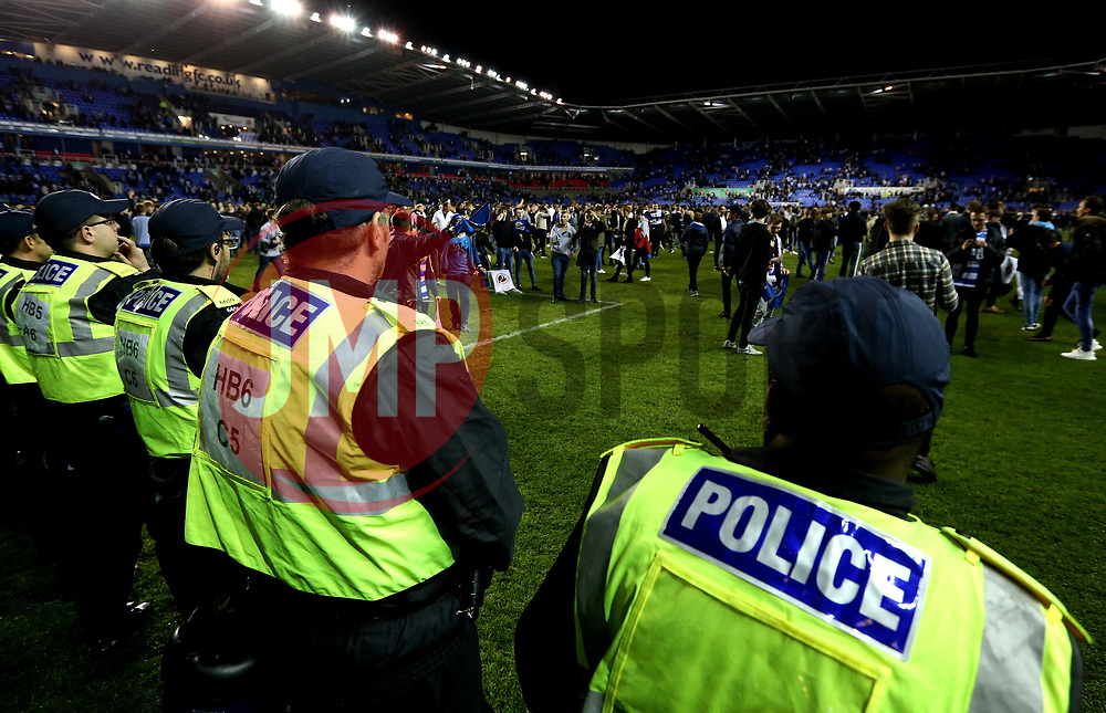 Police line up on the pitch as Reading fans invade the pitch at full time after their side's win over Fulham in the Championship Playoff Final - Mandatory by-line: Robbie Stephenson/JMP - 16/05/2017 - FOOTBALL - Madejski Stadium - Reading, England - Reading v Fulham - Sky Bet Championship Play-off Semi-Final 2nd Leg