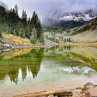 Reflection in lake with mountain and forest