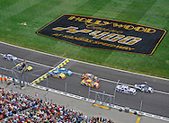 Fox Sports -- NASCAR Sprint Cup Series drivers race across the starting line to begin the Hollywood Casino 400 at the Kansas Speedway.