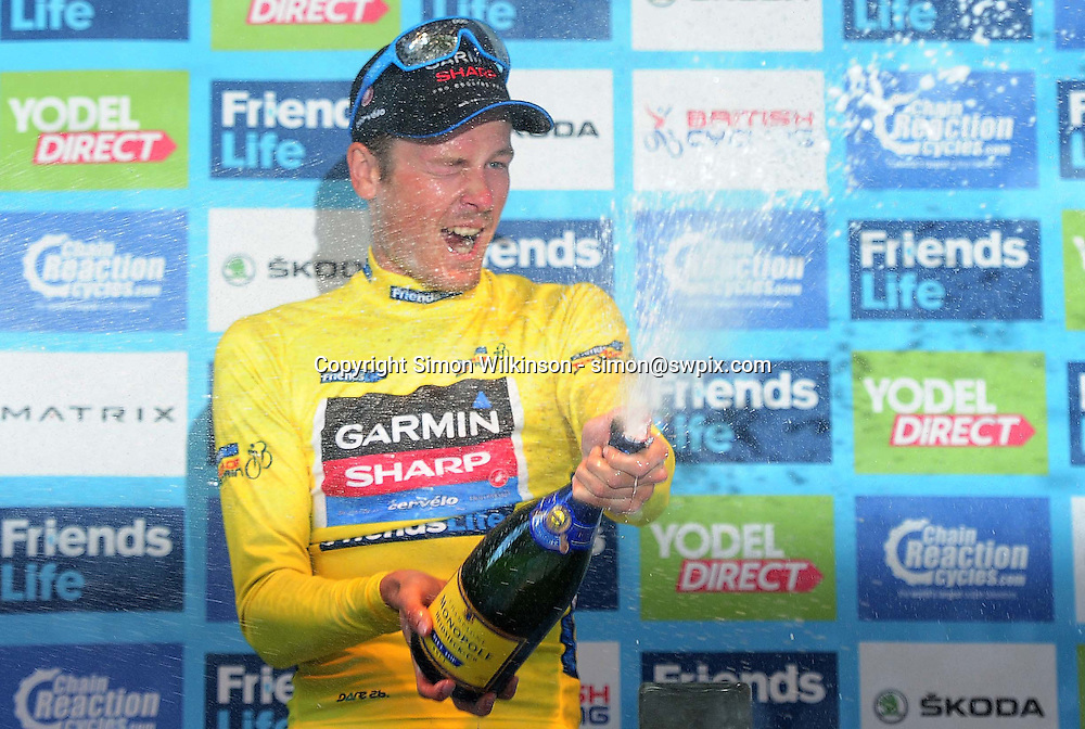 Picture by Simon Wilkinson/SWpix.com - 14/09/2014 - Cycling - 2014 Friends Life Tour of Britain - Stage 8b, London Circuit Race - Garmin-Sharp's Dylan Van Baarle celebrates winning the 2014 Friends Life Tour of Britain yellow jersey.