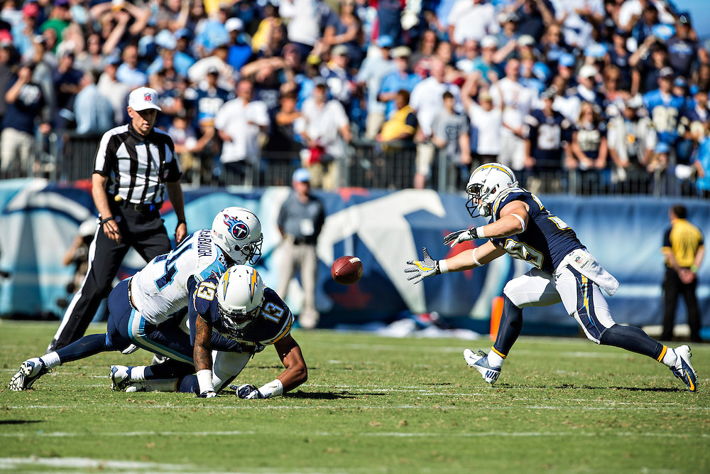 NASHVILLE, TN - SEPTEMBER 22:  Danny Woodhead #39 of the San Diego Chargers goes after a loose ball tossed by teammate Keenan Allen #13 during the last play of the game against the Tennessee Titans at LP Field on September 22, 2013 in Nashville, Tennessee.  The Titans defeated the Chargers 20-17.  (Photo by Wesley Hitt/Getty Images) *** Local Caption *** Danny Woodhead; Keenan Allen