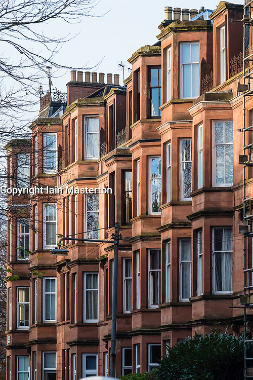 View of typical red sandstone tenement apartment building in queens Park district of Glasgow, Scotland, United Kingdom
