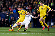 Alex Woodyard of Peterborough United tackles James Henry of Oxford United during the EFL Sky Bet League 1 match between Oxford United and Peterborough United at the Kassam Stadium, Oxford, England on 16 February 2019.