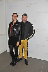 """PHILIPPE STARCK and his wife JASMINE ABDELLATIF at the launch of """"Photo-Me by Starck"""" – a photobooth exclusively designed by the world renowned artist and creator Philippe Starck held at The Saatchi Gallery, Duke Of York Square, Kings Road, London on 2nd November 2011."""