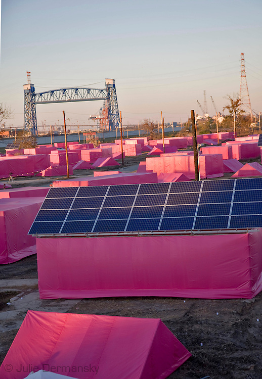 "Pink  models set up to as model of houses that will be built light up the lower 9th ward sky to introduce Brad Pitts affordable housing project in New Orleans.Brad Pitt introduced his ""Making it Right"" low income housing project in the 9th Ward of New Orleans,on December 3, 2007 with a presentation of symbolic pink houses where ultimately environmentally friendly homes will be built."