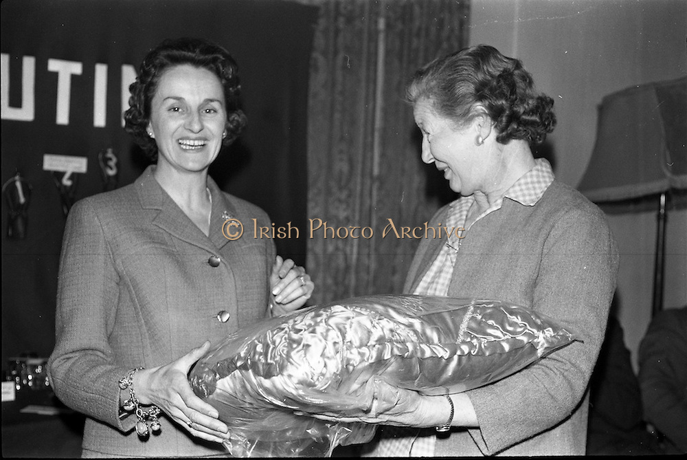 23/05/1963<br /> 05/23/1963<br /> 23 May 1963<br /> Esso Staff Golf Outing at Woodbrook Golf Club, Co. Dublin. Image from the prize giving after the event in the Golf Club. Mrs J. Donovan, wife of Esso Director, John Donovan, on left, presenting the prizes, in this case a cushion.