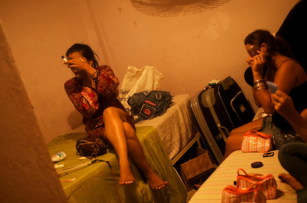 Prostitutes get ready doing their hair and makeup in a brothel in Cartagena, Colombia. A sex scandal erupted recently when secret service agents were found bringing prostitutes to their hotel rooms while in Cartagena preparing for President Barack Obama's arrival to the Summit of the Americas.