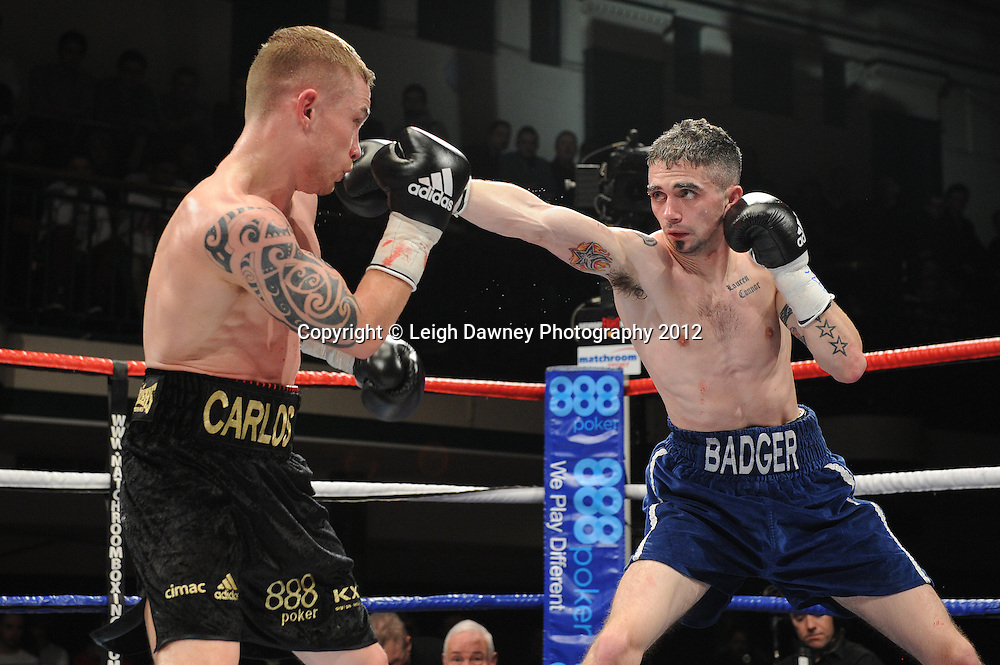 Carl Frampton (black shorts) defeats Kris Hughes for The Commonwealth  Super Bantamweight Title on the 28th January 2012 at York Hall, Bethnal Green, London. Matchroom Sport. © Leigh Dawney Photography 2012.