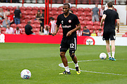Brentford Midfielder Kamohelo Mokotjo (12) warms up before kick off during the EFL Sky Bet Championship match between Brentford and Queens Park Rangers at Griffin Park, London, England on 21 April 2018. Picture by Andy Walter.