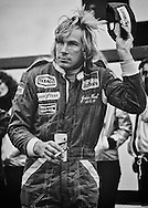 British 1976 World Champion James Hunt, beer in hand, salutes the crowd after winning the 1977 United States Grand Prix at Watkins Glen. There might not be a better example of what has changed from the &quot;romantic&quot; era of the 70's to what we experience today.<br />