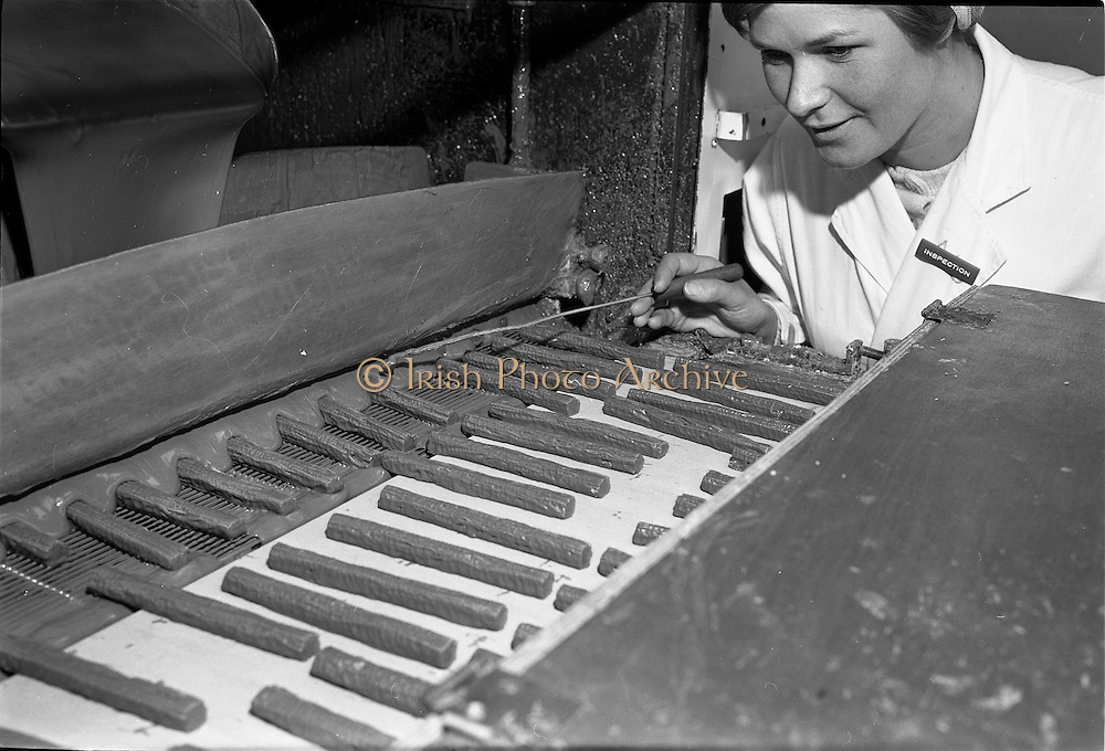 28/05/1962<br /> 05/28/1962<br /> 28 May 1962<br /> Fry-Cadbury factory on the Malahide Road, Dublin. Picture shows mint filled centres being coated in chocolate machine while watched by inspector.