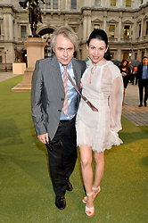 NICK RHODES and NEFER SUVIO at the annual Royal Academy of Art Summer Party held at Burlington House, Piccadilly, London on 4th June 2014.