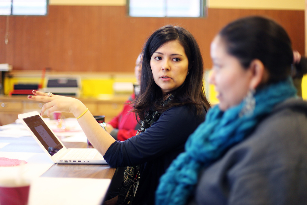 Aurora Jimenez leads a weekly parent-teacher meeting at King Elementary School on Wednesday, March 7, 2012.