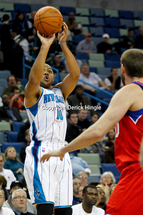 January 4, 2012; New Orleans, LA, USA; New Orleans Hornets shooting guard Eric Gordon (10) shoots against the Philadelphia 76ers during the first quarter of a game at the New Orleans Arena.   Mandatory Credit: Derick E. Hingle-US PRESSWIRE