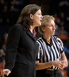 Virginia Tech's head coach Beth Dunkenburger discusses a call with official Beverly Roberts