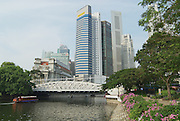 SINGAPORE, SINGAPORE - AUGUST 05, 2008: View to the modern buildings and the old Cavenagh bridge in Singapore, Singapore.