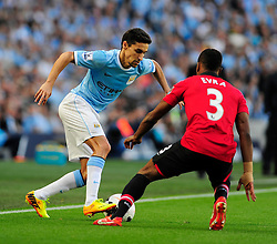 Manchester City's Jesus Navas and Manchester United's Patrice Evra - Photo mandatory by-line: Dougie Allward/JMP - Tel: Mobile: 07966 386802 22/09/2013 - SPORT - FOOTBALL - City of Manchester Stadium - Manchester - Manchester City V Manchester United - Barclays Premier League