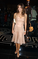 LIZ HURLEY at a party hosted by Versace during London Fashion Week 2005 at their store in Slaone Street, London on 19th September 2005.<br /><br />NON EXCLUSIVE - WORLD RIGHTS