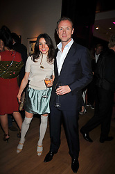 GARY & LAUREN KEMP at fundraising dinner and auction in aid of Liver Good Life a charity for people with Hepatitis held at Christies, King Street, London on 16th September 2009.