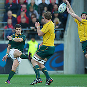 Morne Steyn, South Africa, kicks a drop goal past the outstretched hands of Berrick Barnes, Australia, during the South Africa V Australia Quarter Final match at the IRB Rugby World Cup tournament. Wellington Regional Stadium, Wellington, New Zealand, 9th October 2011. Photo Tim Clayton...