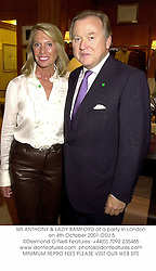 SIR ANTHONY & LADY BAMFORD at a party in London on 4th October 2001.			OSU 5