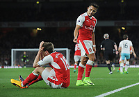 Football - 2016 / 2017 Premier League - Arsenal vs. West Ham United<br /> <br /> Alexis Sanchez of Arsenal tells team mate Nacho Monreal to get up after diving in the penalty box at The Emirates.<br /> <br /> COLORSPORT/ANDREW COWIE