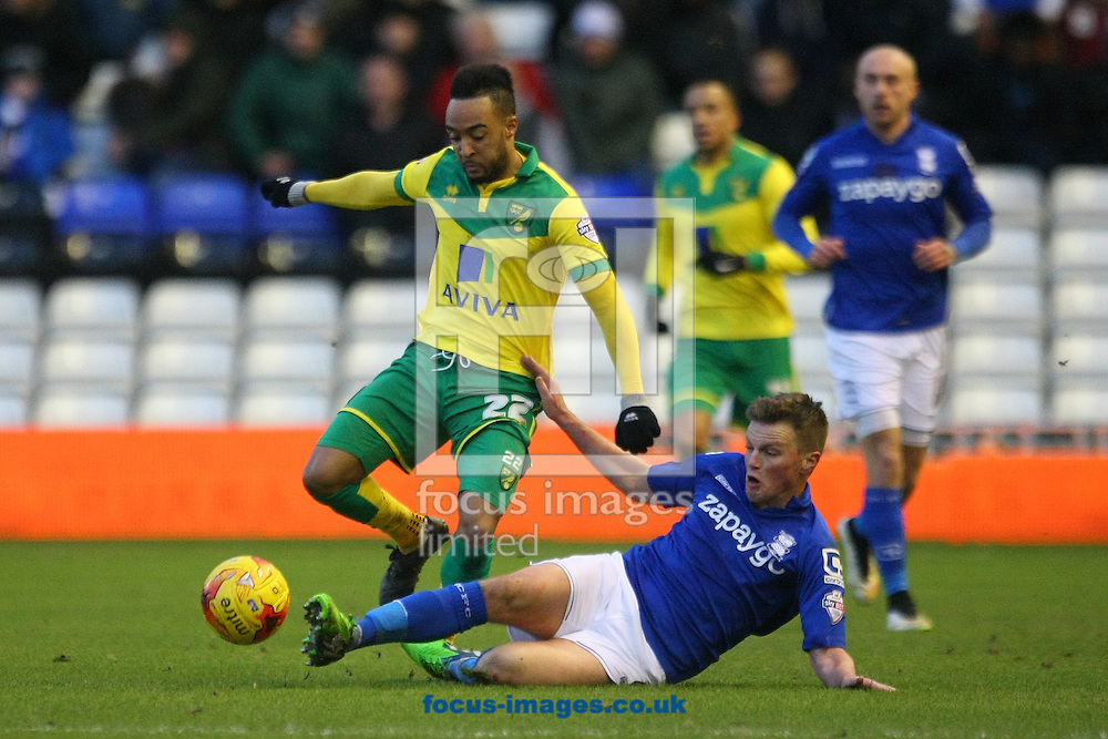 Nathan Redmond of Norwich and Stephen Gleeson of Birmingham in action during the Sky Bet Championship match at St Andrews, Birmingham<br /> Picture by Paul Chesterton/Focus Images Ltd +44 7904 640267<br /> 31/01/2015