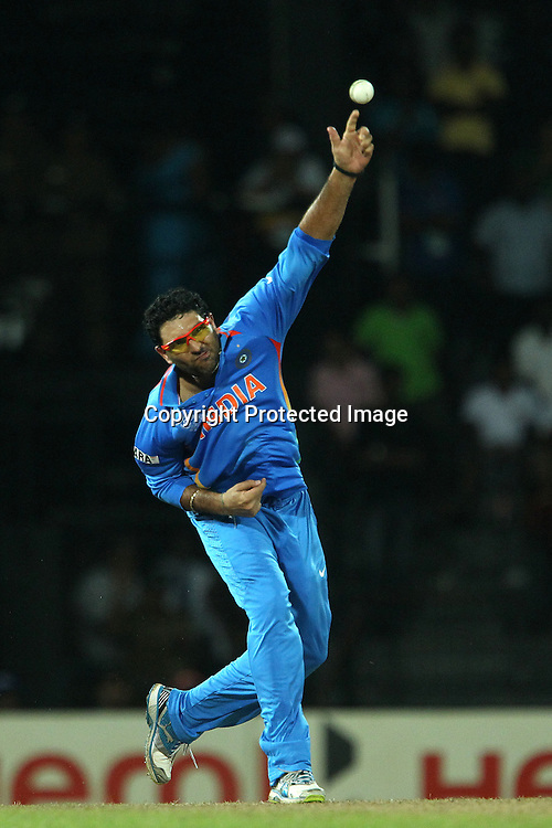 Yuvraj Singh bowls during the ICC World Twenty20 Super 8s match between Australia and India held at the Premadasa Stadium in Colombo, Sri Lanka on the 28th September 2012<br /> <br /> Photo by Ron Gaunt/SPORTZPICS