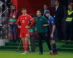 TRNAVA, SLOVAKIA - Thursday, October 10, 2019: Wales' Kieffer Moore (L) and Slovakia's Norbert Gyömber stand on the sidelines after being treated for head injuries during the UEFA Euro 2020 Qualifying Group E match between Slovakia and Wales at the Štadión Antona Malatinského. (Pic by David Rawcliffe/Propaganda)