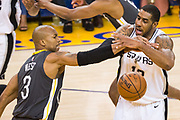 Golden State Warriors forward David West (3) fouls San Antonio Spurs forward LaMarcus Aldridge (12) during Game 2 of the Western Conference Quarterfinals at Oracle Arena in Oakland, Calif., on April 16, 2018. (Stan Olszewski/Special to S.F. Examiner)
