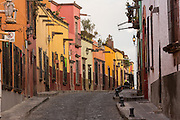 Spanish colonial style homes along the cobblestone Recreo street in the historic center of San Miguel de Allende, Mexico.