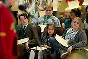 Rider Isgett, left to right, Lillian Nguyen and Caroline Plank watch a fellow participant spell a word during the Southeast Ohio Regional Spelling Bee Saturday, March 16, 2013. The Regional Spelling Bee was sponsored by Ohio University's Scripps College of Communication and held in Margaret M. Walter Hall on OU's main campus.