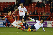 Nottingham Forest striker Jamie Ward and Bolton Wanderers midfielder Neil Danns dive in for the tackle during the Sky Bet Championship match between Nottingham Forest and Bolton Wanderers at the City Ground, Nottingham, England on 16 January 2016. Photo by Alan Franklin.