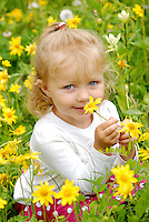 This sweet girl enjoys picking the flowers near the columbine patch by Hot Sulphur Springs, CO