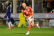 James O'Connor celebrates scoring Walsall's first goal during the Capital One Cup match between Walsall and Chelsea at the Banks's Stadium, Walsall, England on 23 September 2015. Photo by Alan Franklin.