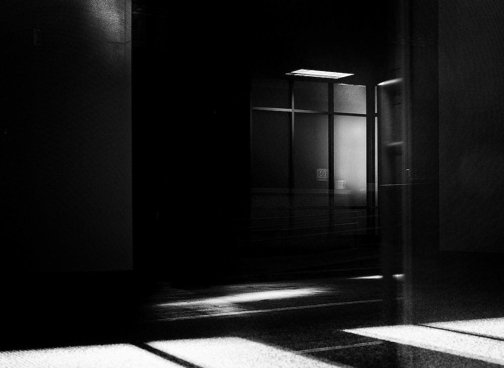 Photograph taken thru an urban building showing a vacant office space.