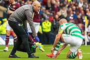 Celtic Captain requests a change of footwear during the William Hill Scottish Cup Final match between Heart of Midlothian and Celtic at Hampden Park, Glasgow, United Kingdom on 25 May 2019.