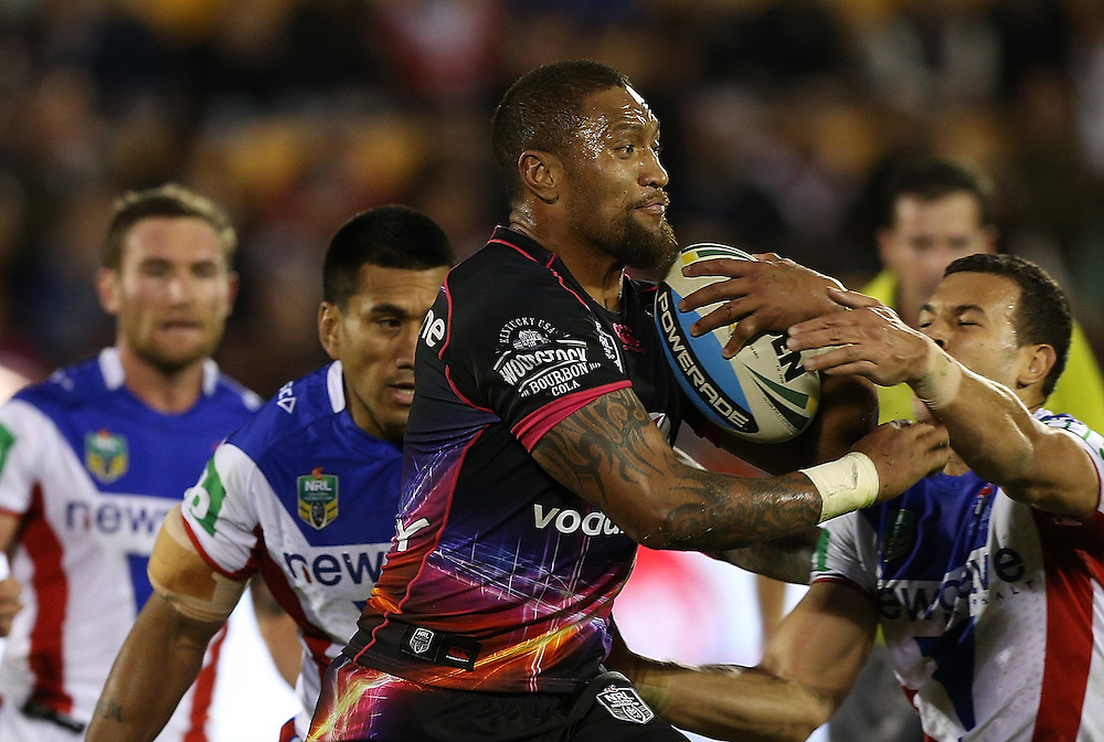Manu Vatuvei of the New Zealand Warriors is challenged by Carlos Tuimavave of the Newcastle Knights during their round 12 NRL match at Mount Smart Stadium, Auckland on  Sunday, May 31, 2015. Credit: SNPA / David Rowland
