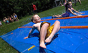 ROXBURY, CT- 12 JUNE 2008- 061208JT01-.Booth Free School first graders Michael McCluskey and Hannah Lasky race each other on an obstacle course behind the Roxbury school during its annual Field Day on Thursday. More than 120 students from Kindergarten to fifth grade participated in stations that featured various games and competitions..Josalee Thrift / Republican-American