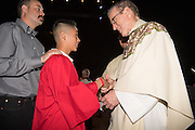 DENVER, CO - MAY 7:  Candidates get confirmed during the Archdiocese of Denver's inaugural Sealed and Sent event at the Denver Coliseum  on May 7, 2016 in Denver, Colorado. (Photo by AAron Ontiveroz for the Archdiocese of Denver)