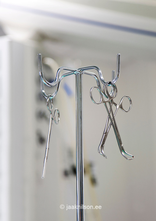 Surgical support equipment. Instrument stand and metal scissors and clamps.