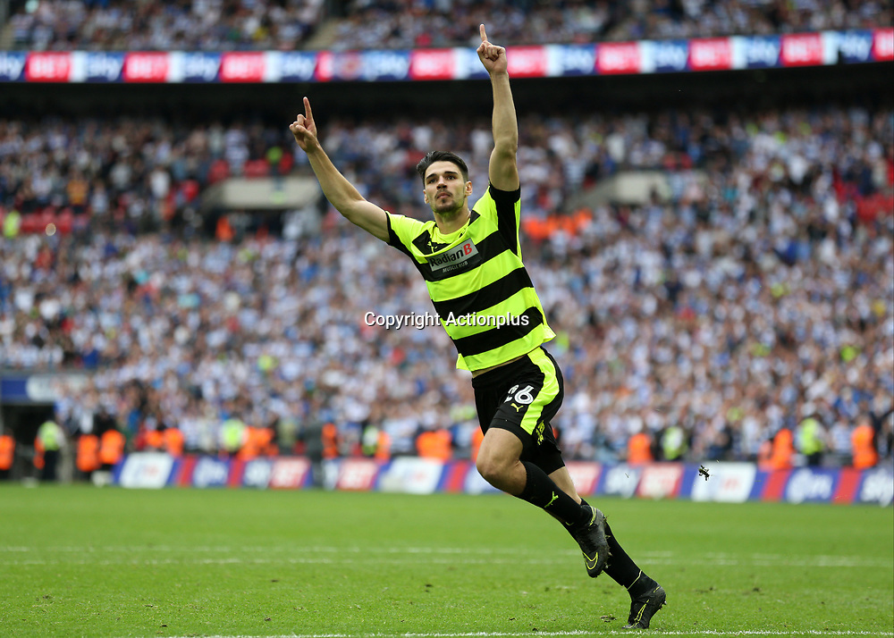 May 29th 2017, Wembley Stadium, London, England; EFL Championship playoff final, Huddersfield Town versus Reading; Christopher Schindler of Huddersfield Town celebrates scoring the winning penalty to promote Huddersfield Town into the Premier League