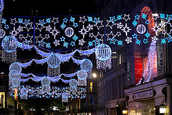 © Licensed to London News Pictures. 09/11/2013. Birmingham, UK. Pictured, Christmas lights on New Street. Crowds packed Birmingham City Centre to watch the Lord Mayor Switch on the Cristmas Lights and start the Christmas parade. Along with reindeer, panto characters, street artists, musicians, three camels also joined the parade carrying the Three Kings. At the close of the parade it snowed in Victoria Square. Photo credit : Dave Warren/LNP
