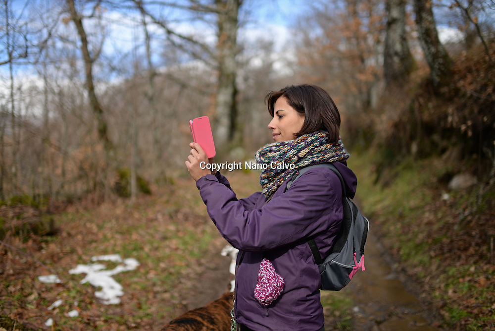 Young woman using mobile phone in nature