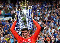 Football - 2014 / 2015 Premier League - Chelsea vs. Sunderland.   <br /> <br /> Chelsea's Thibaut Courtois  with the Premier League Trophy at Stamford Bridge. <br /> <br /> COLORSPORT/DANIEL BEARHAM