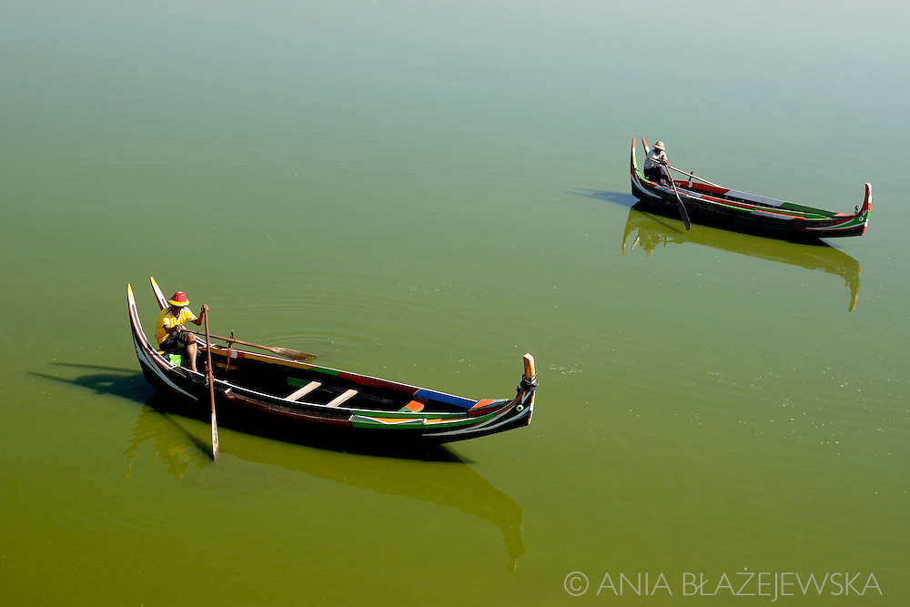 Burma/Myanmar, Amarapura. Sampans on Taungthaman Lake.