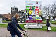 Nederland, Nijmegen, 20-2-2014Verkiezingscampagne van partijen voor de lokale verkiezingen. Verschillende lokale partijen doen mee. Het bord is voorbedrukt door bordbusters zodat iedereen dezelfde ruimte heeft.Foto: Flip Franssen/Hollandse Hoogte