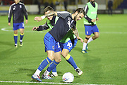 AFC Wimbledon defender Callum Kennedy (23) and AFC Wimbledon striker Cody McDonald (10) warming up during the EFL Trophy match between AFC Wimbledon and Tottenham Hotspur at the Cherry Red Records Stadium, Kingston, England on 3 October 2017. Photo by Matthew Redman.